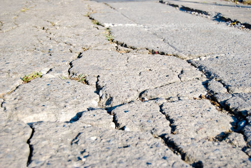 Cracked road flooring texture