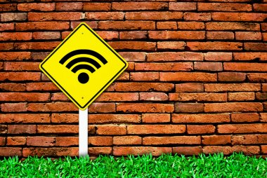 Wi-fi internet symbol on brick wall