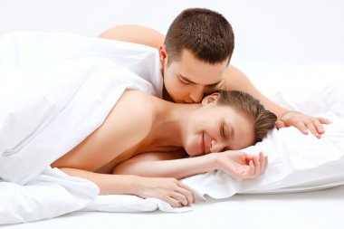 Lover couple in bed