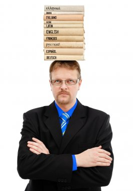 Man with language books on head