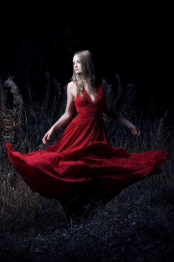 Portrait of dancing woman at forest