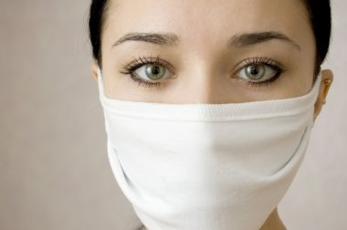 Face of beautiful women in a medical mask