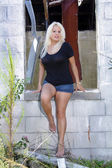 Fotografie Beautiful Blonde at an Abandoned House (8)