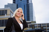Fotografie Beautiful Businesswoman Outdoors (1)