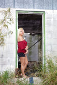 Fotografie Beautiful Blonde in a Dilapidated House (1)