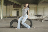 Fotografie Sexy Brunette with Tattered Jeans (2)