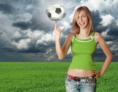 Happy girl with soccer ball on blue sky
