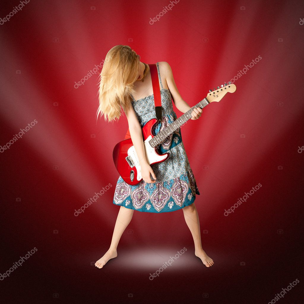 Hippie girl with electric guitar