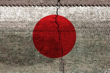 Cracked brick wall as Japan flag, symbolize the recent earthquake stock vector
