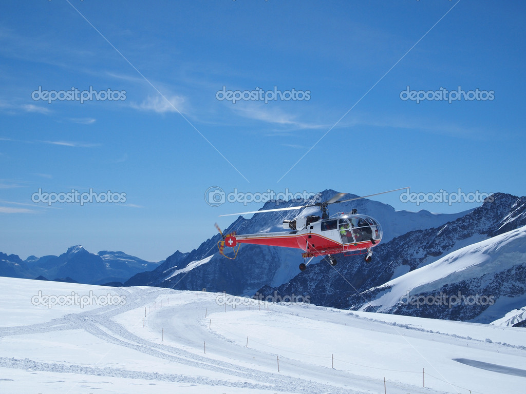Helicopter take-off at Jungfraujoch Top of Europe in the Swiss M