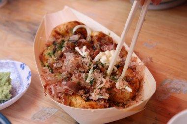 Takoyaki (literally fried or grilled octopus)