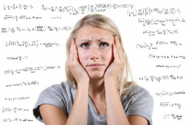 Desperate woman with many mathematical equations around her