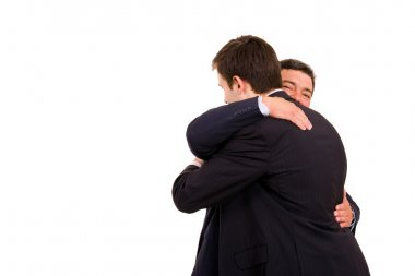 Happy embracing of two business men, isolated on white