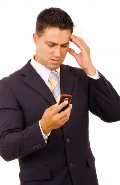 Young businessman with bad news on his cell phone stock vector