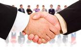 Közelkép kép üzletemberek, kézfogások, hogy egy egyetért