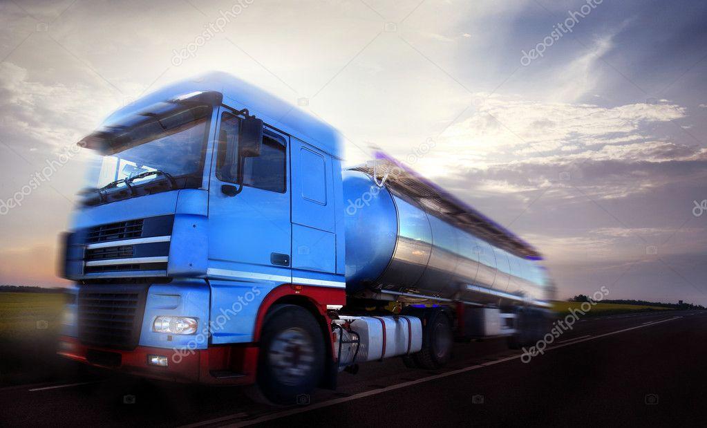 Truck driving at dusk motion blur