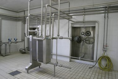 Temperature controlled pressure tanks and valves in factory