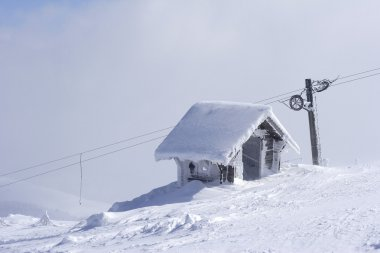 Snow shelter on mountain top