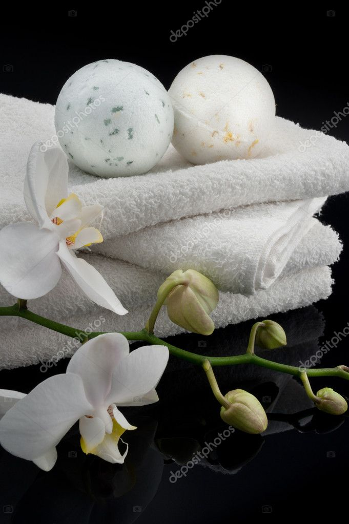 Towels with orchid and bath balls