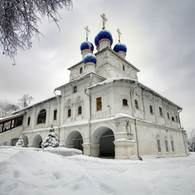 Orthodox chapel on the background of the dramatic cloudy sky