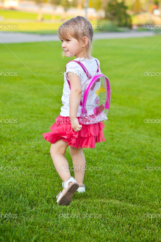 Little pretty girl walks in park