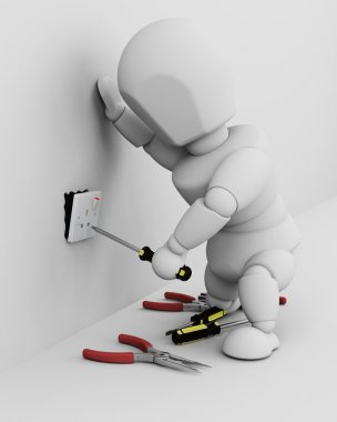 Electrician fitting an electrical socket