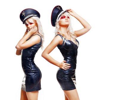 Sexy twins wearing short black dresses