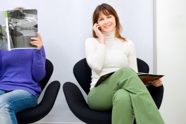 Two women sitting in the waiting room