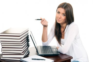 Business woman working laptop and pen in hand