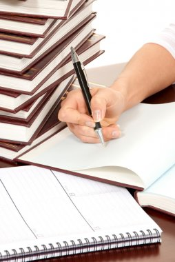 Person hand with pen signing book document