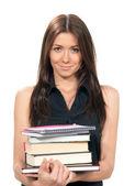 Mladá žena drží knihy, poznámkové bloky v dlaních