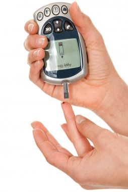 Diabetes patient making glucose level blood test