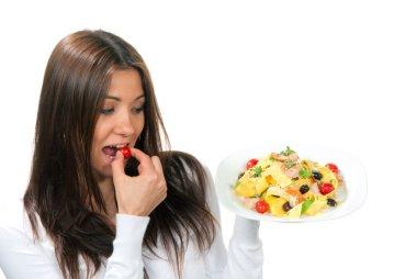 Woman hold plate of diet Italian Shrimp Penne pasta