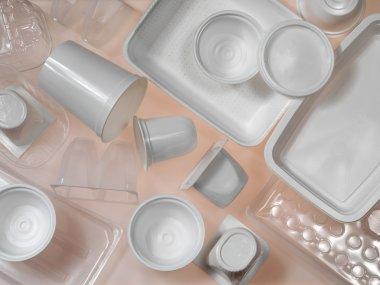 Containers of plastic and polystyrene