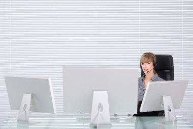 Secretary portrait in a clean high tech office