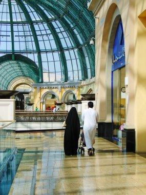 Arab family shopping in supermarket in Dubai