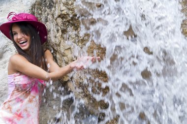 Pink hat and waterfall