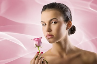 Close up portrait of a pretty brunette with a pink rose looking in camera stock vector