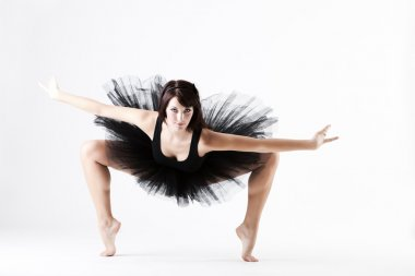Young beautiful ballet dance holding difficult pose