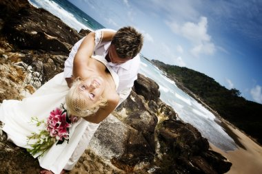 Passionate young couple getting married on the beach