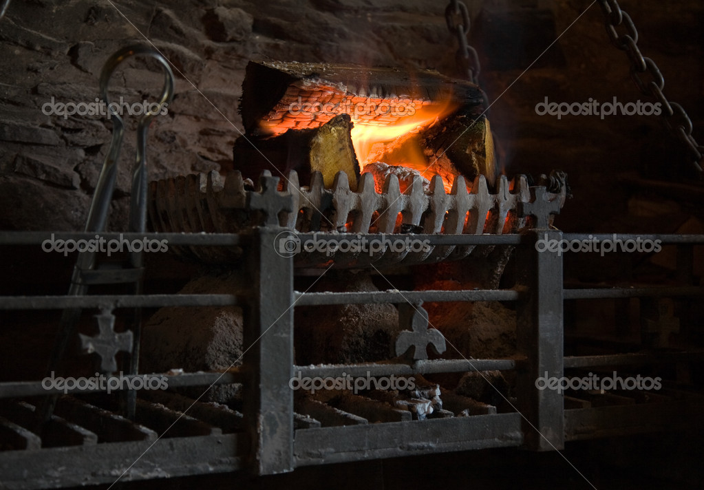 Old fashioned lit fireplace with wood fire — Stock Photo ...