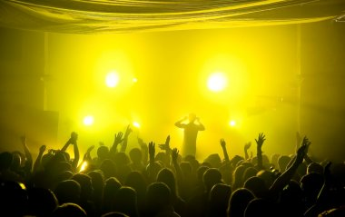 Underground club music concert with yellow lights