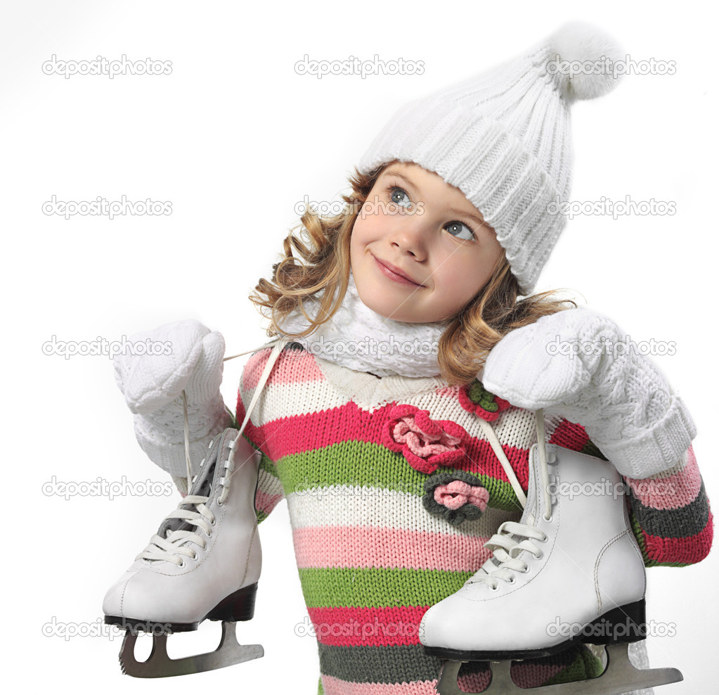 Girl in winter clothes with figure skates