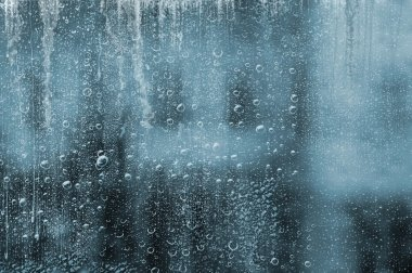 RAIN DROPS ON THE WINDOWPANE