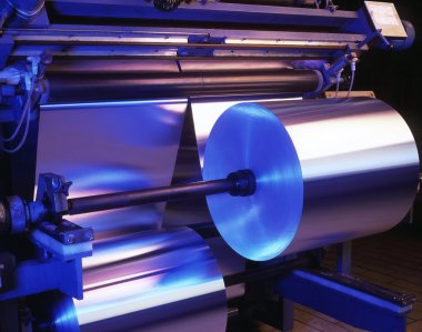 Machine processing thin aluminum foil in a factory