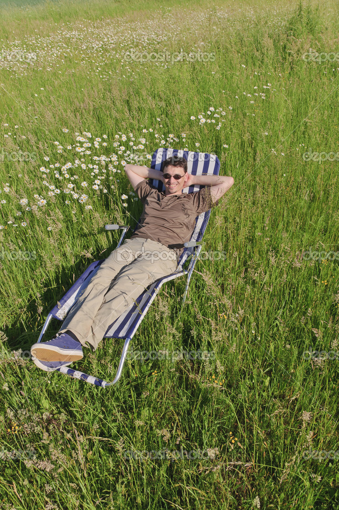 Man in meadow relaxing