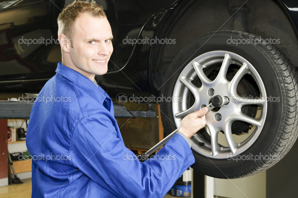 Changing wheels in car workshop