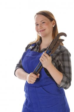 Cute young crafts woman with chain wrench