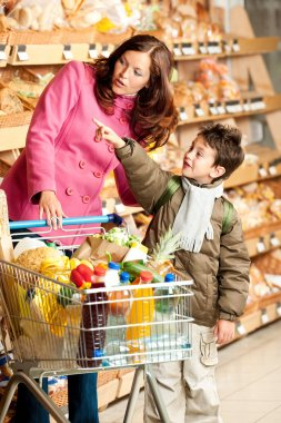 Grocery store shopping - Woman with child