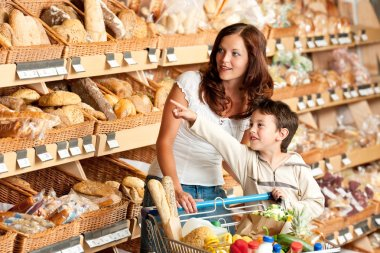 Grocery store shopping - Woman with child in a supermarket